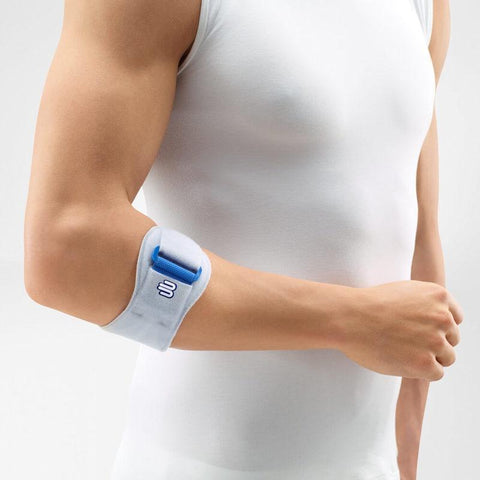 Elbow brace/support having a colour combination of blue and white, is wore on right elbow. With the logo of Bauerfeind that is consider as one of their best elbow braces for tennis which is named as EpiPoint Elbow Strap.