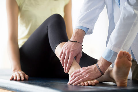 Patient being assessed for a sprained ankle