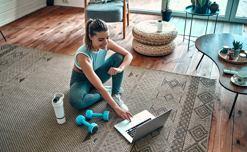 Woman doing an at-home group fitness online workout which is shown to help improve mental health