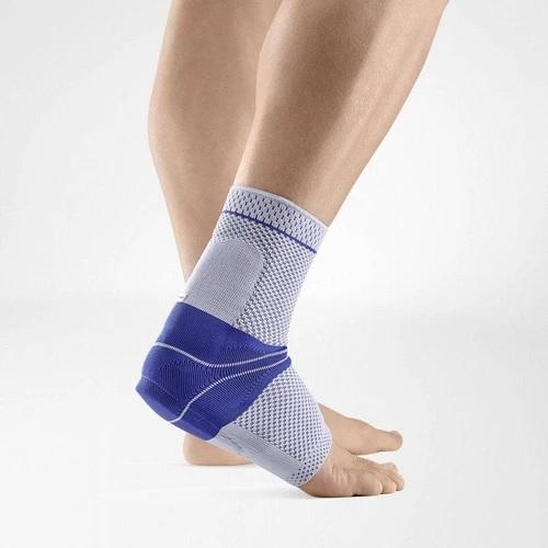 Ankle support in a colour combination of blue and grey and is worn on the right ankle. It is considered one of Bauerfeind Australia's best recovery ankle supports, AchilloTrain Ankle Support.