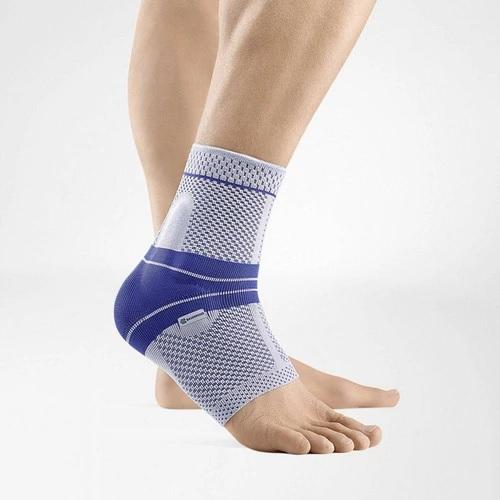 Ankle support in a colour combination of blue and grey and is worn on the right ankle. It is considered one of Bauerfeind Australia's best recovery ankle supports, MalleoTrain Ankle Support.