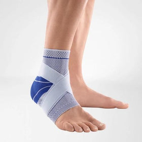 Ankle support in a colour combination of blue and grey and is worn on the right ankle. It is considered one of Bauerfeind Australia's best recovery ankle supports, MalleoTrain Plus Ankle Support.