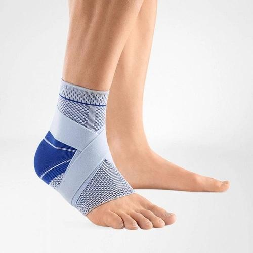 Ankle support in a colour combination of blue and grey and is worn on the right ankle. It is considered one of Bauerfeind Australia's best recovery ankle supports, MalleoTrain s Ankle Support.