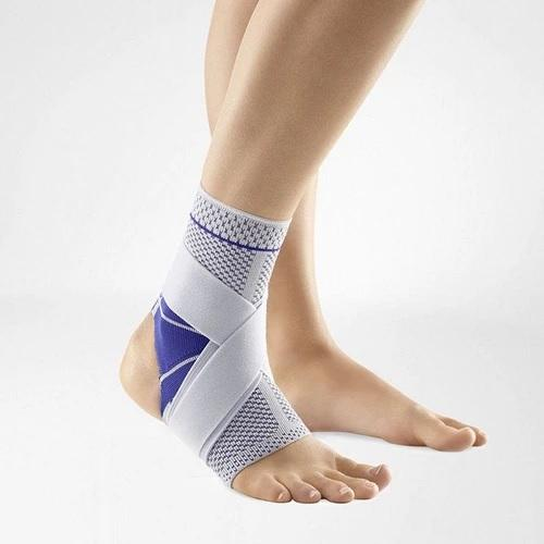 Ankle support in a colour combination of blue and grey and is worn on the right ankle. It is considered one of Bauerfeind Australia's best recovery ankle supports, MalleoTrain S Open Heel Ankle Support.