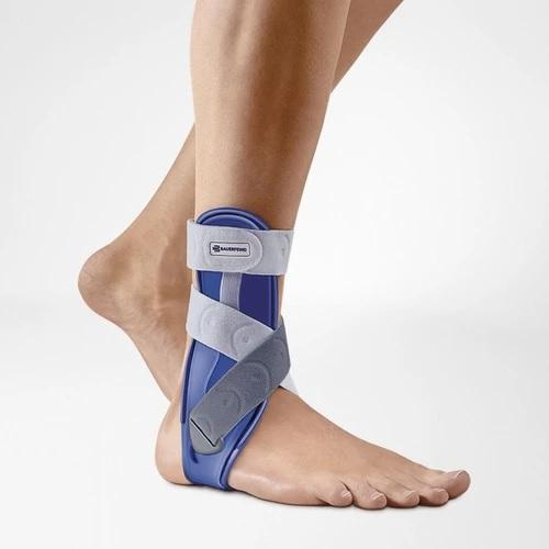 Ankle support in a colour combination of blue and grey and is worn on the right ankle. It is considered one of Bauerfeind Australia's best recovery ankle supports, Malleoloc Ankle Splint.
