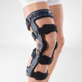 Knee brace in a colour combination of blue and black and is worn on the right knee. It is considered one of Bauerfeind Australia's best recovery knee braces, Secutec OA.