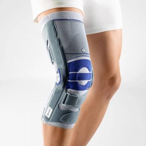 Knee brace in a colour combination of blue and grey and is worn on the right knee. It is considered one of Bauerfeind Australia's best recovery knee braces, Softec Genu.