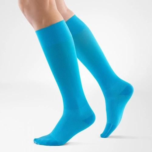 A blue colour leg compression sleeves with the logo of Bauerfeind Australia on it and being worn on both legs. It is considered one of the best sports compression socks for run and walk.