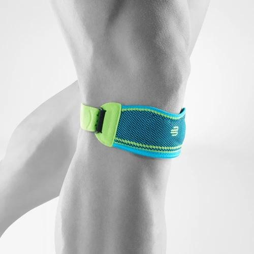 Knee strap in a colour combination of blue and green with the logo of Bauerfeind Australia and being worn on the right knee. It is considered one of the best Sports Knee Straps.