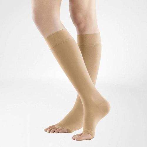 A caramel colour compression stockings. It is one of Bauerfeind Australia's best compression stockings, VenoTrain Knee High Open Toe Compression Stockings (Caramel).