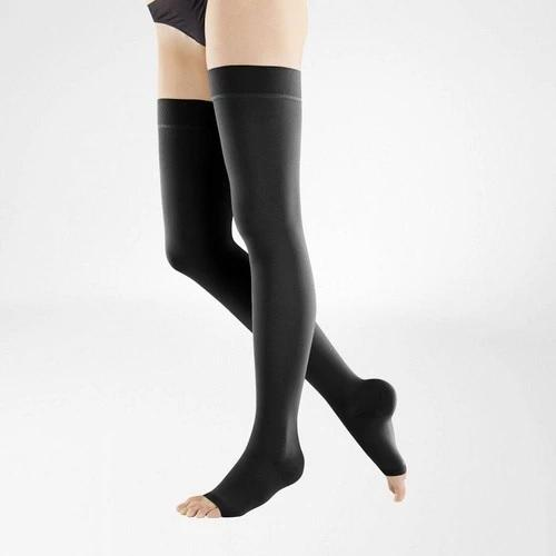 Compression stockings in black colour and is worn on both legs. It is considered as one of Bauerfeind Australia's best recovery supports and braces, the VenoTrain Open Toe Compression Stockings (Black).