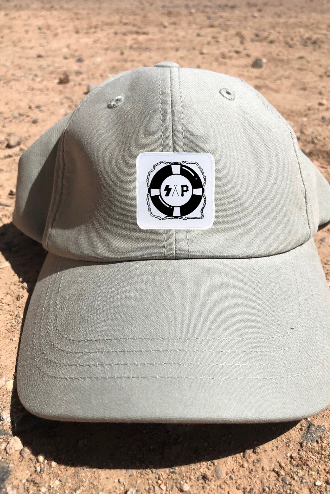 "stone ""lifesaver"" sueded cap"