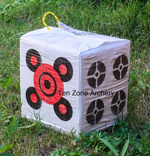 BCE economy compound bow target block with carry handle from Ten Zone Archery pictured outside on green grass.