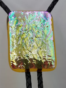 bolo tie of rough textured iridescent gold dichroic fused glass with black leather