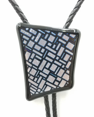 bolo tie of Silver & Black dichroic glass in an interesting geometric pattern backed by black glass