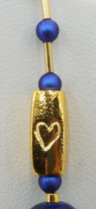 Tiny hearts on the gold plated tube beads