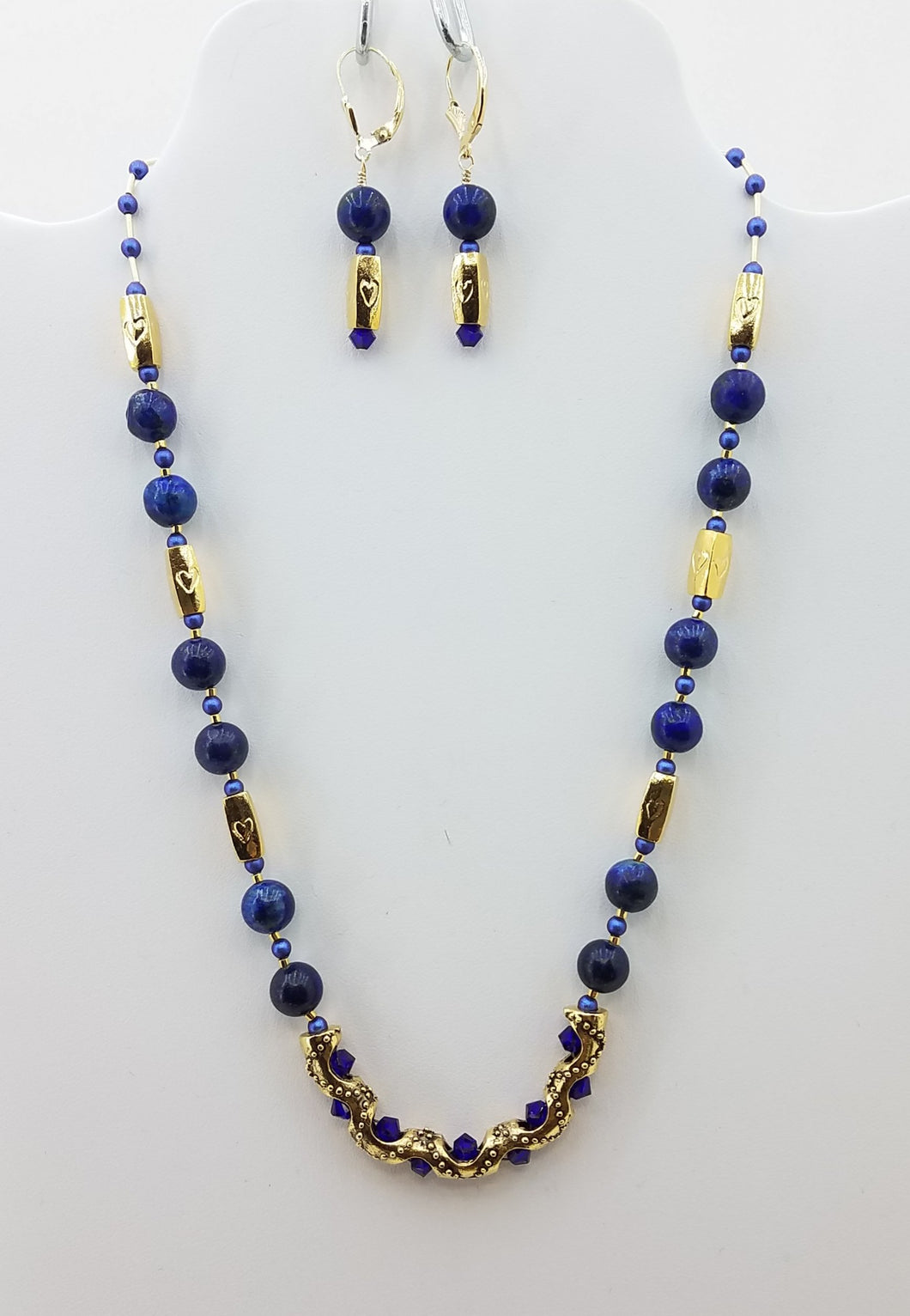 Necklace of Beautiful Lapis Lazuli Stones surround a Gold Plated Tube adorned with Swarovski Crystals. Also includes Swarovski Pearls, Miyuki Delica, Gold Fill, and Gold Plate.