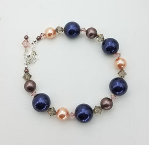 A lightweight and long combination of Swarovski Crystals & Pearls in night blue, peach, & brown velvet,  & Sterling Silver Bracelet