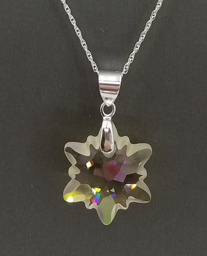 Necklace - This edelweiss crystal pendant is a soft, luminescent green which sparkles in light.