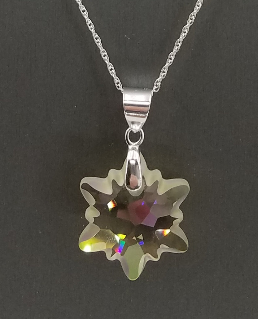 Necklace - This Swarovski  edelweiss pendant is a soft, luminescent green which sparkles in light.