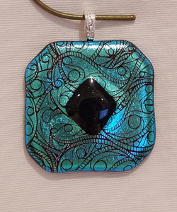 I added a raised black aventurine glass diamond to the center of this turquoise ribbonetched dichroic piece!