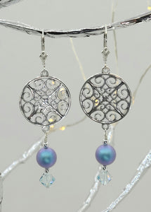 Iridescent light blue crystals* & crystal pearls* dangle from a delicate sterling silver filigree circle