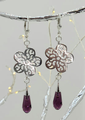 These sterling silver flowers host an amethyst pure drop crystal*