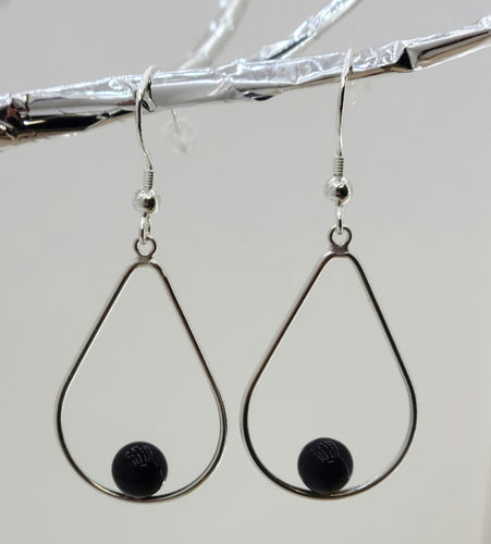 Each sterling silver open teardrop hosts a 6mm black onyx bead. 2