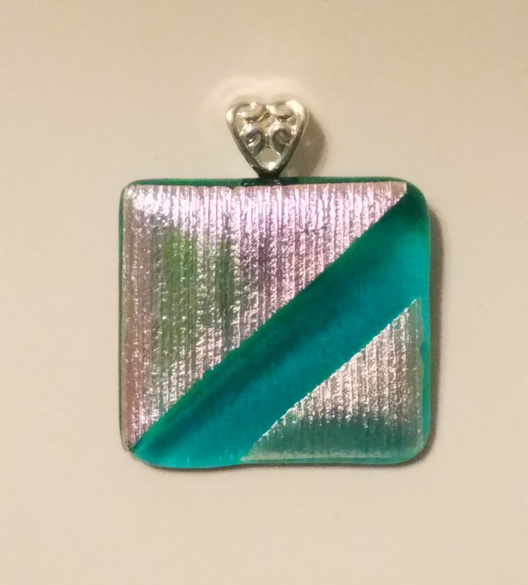 Pink & gold textured striped dichroic glass triangles fused to teal translucent glass. Pendant