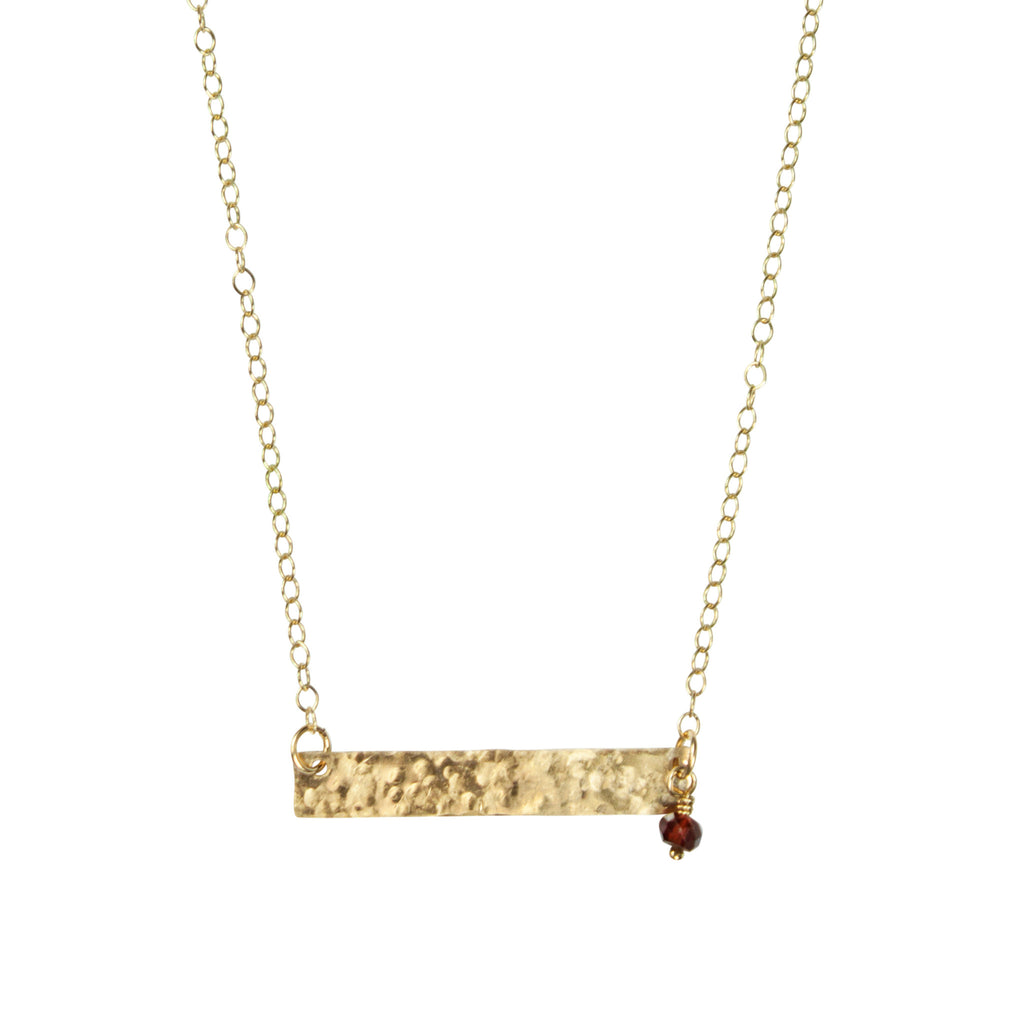 Gold bar necklace with garnet accent