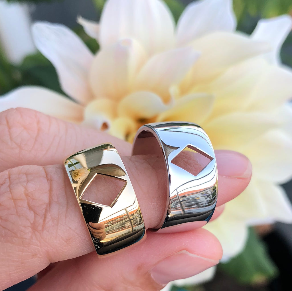 Gold and silver cigar bands with diamond cut-outs