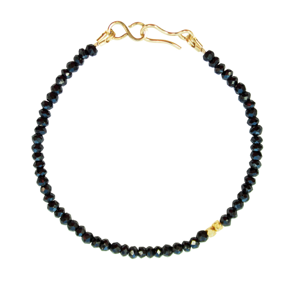 Black onyx bracelet with gold accent beads