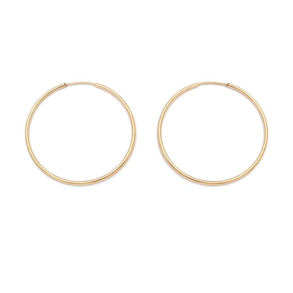 Mid-sized gold hoop earrings