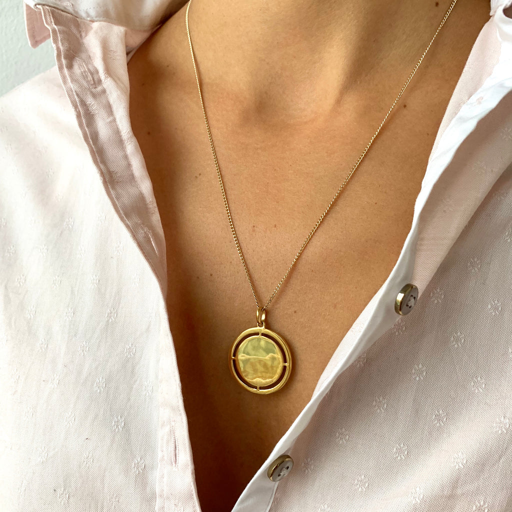 Medallion Pendant Necklace with cut-outs in gold on model