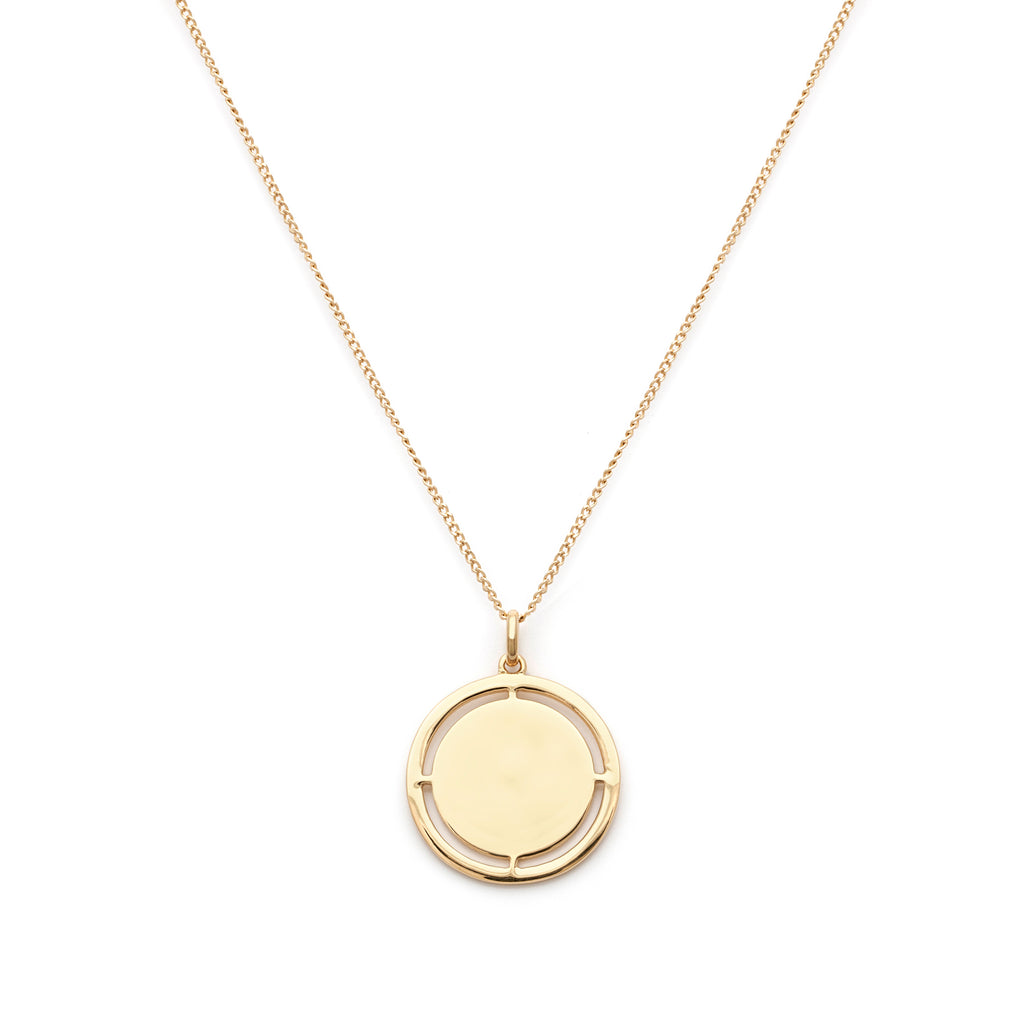 Medallion Pendant Necklace with cut-outs in gold