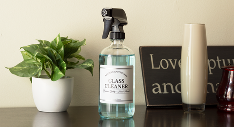 """Clear glass sprayer bottle with label that reads """"Glass Cleaner"""""""