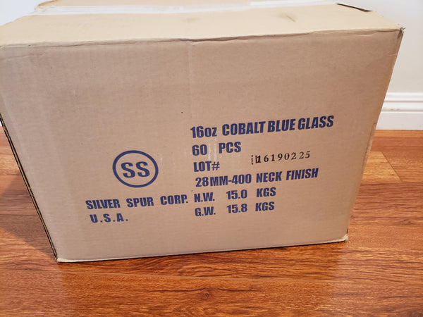 Case of 60 cobalt blue glass bottles (28-400) with small, white scratches
