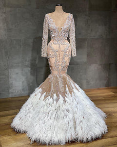 Champagne Mermaid Wedding Dresses With Feathers Sexy See Through Lace Appliqued Crystal Beaded Bridal Gown