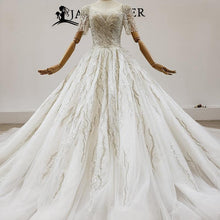 Load image into Gallery viewer, Luxuriously Embellished With Pearl Sequin Crystal O-Neck Wedding Dress Big Train Short Sleeve wedding dress