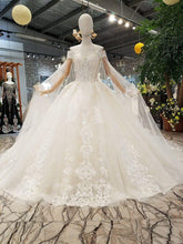Load image into Gallery viewer, off the shoulder short sleeve ball gown lace beaded light champagne / ivory wedding dress with long cape hochzeitskleid