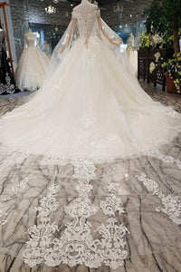off the shoulder short sleeve ball gown lace beaded light champagne / ivory wedding dress with long cape hochzeitskleid