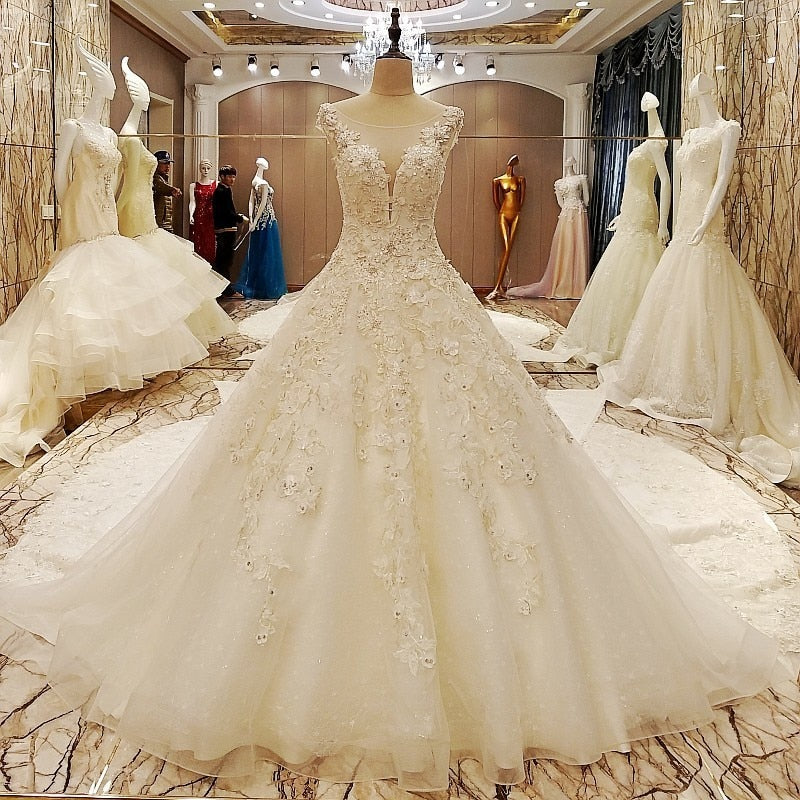 Elegant bridal gowns cape sleeves ball gown flower wedding gowns with long tail robe de mariage - moonaro