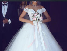 Load image into Gallery viewer, White Lace Appliques Ball Gown Wedding Dresses Off The Shoulder Short Sleeves Bridal Dresses Wedding Gowns - moonaro