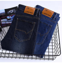 Load image into Gallery viewer, 2019 Autumn Winter New Men's Slim Jeans Business Casual Elastic Skinny Jean Black Blue Denim Pants Male Brand Trousers - moonaro