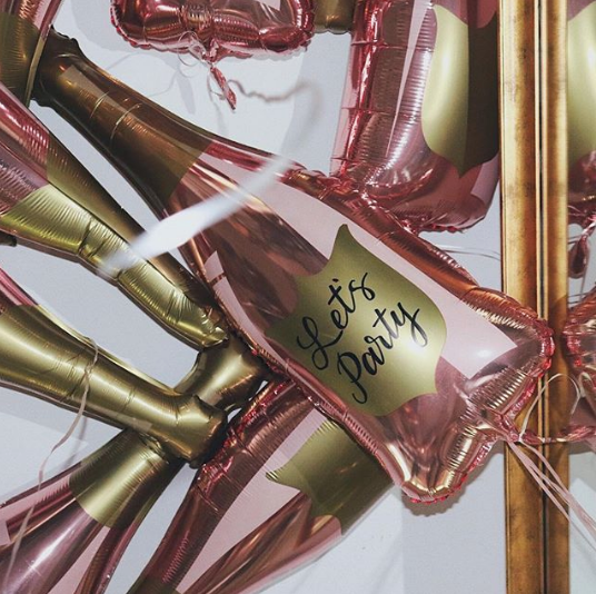 Dozen Rose Gold Champagne Bottle Balloons - Paper Confetti Events