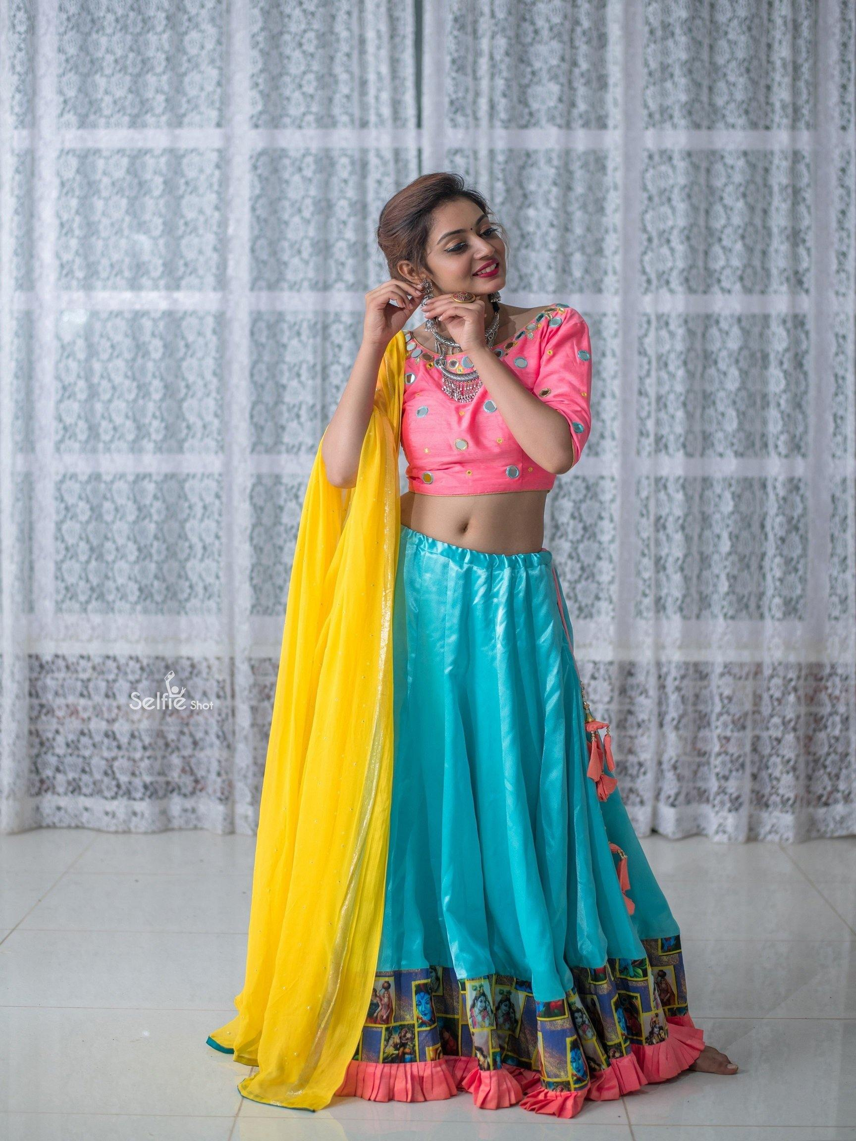 Yellow Pink and Teal colored Chaniya Choli