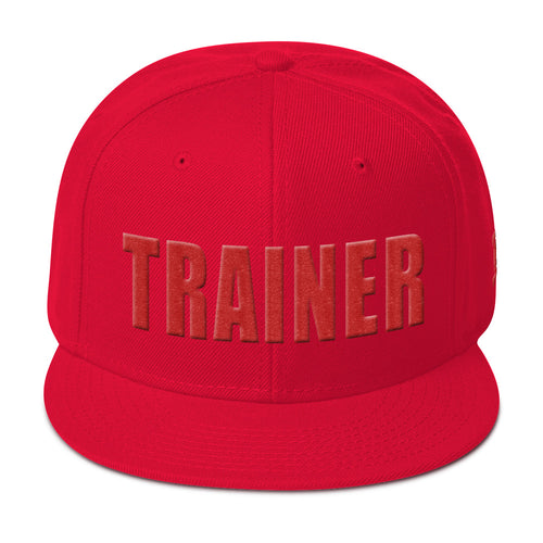 Red personal trainer snapback hat with the word trainer embroidered on the front in red.