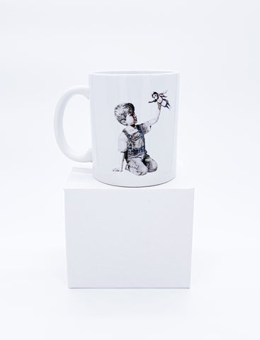 11 oz ceramic mug illustrating Banksy design boy playing with nurse in support for keyworkers