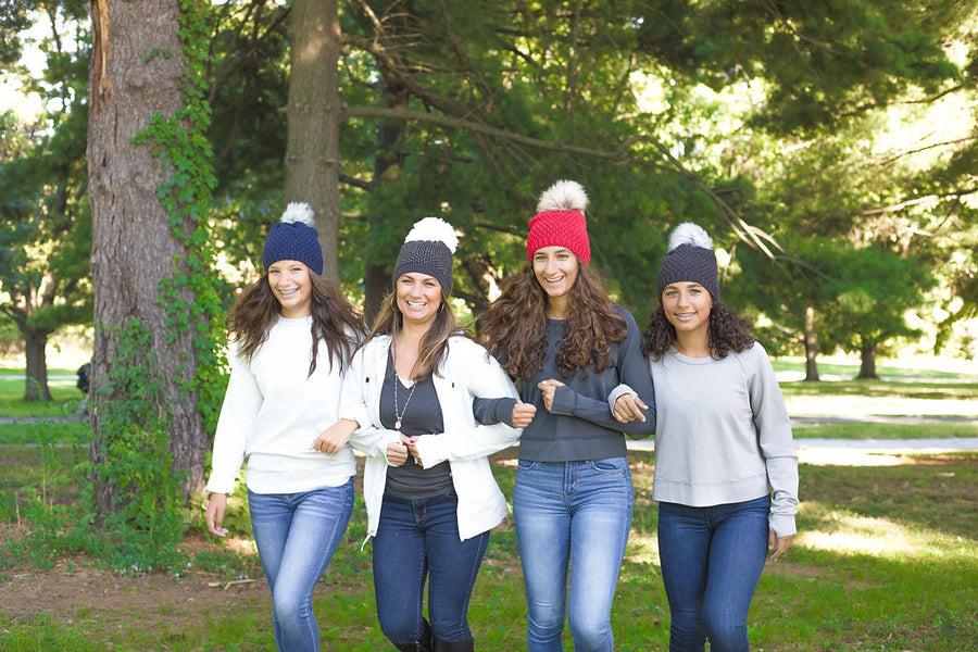 Group wearing Pom Hats