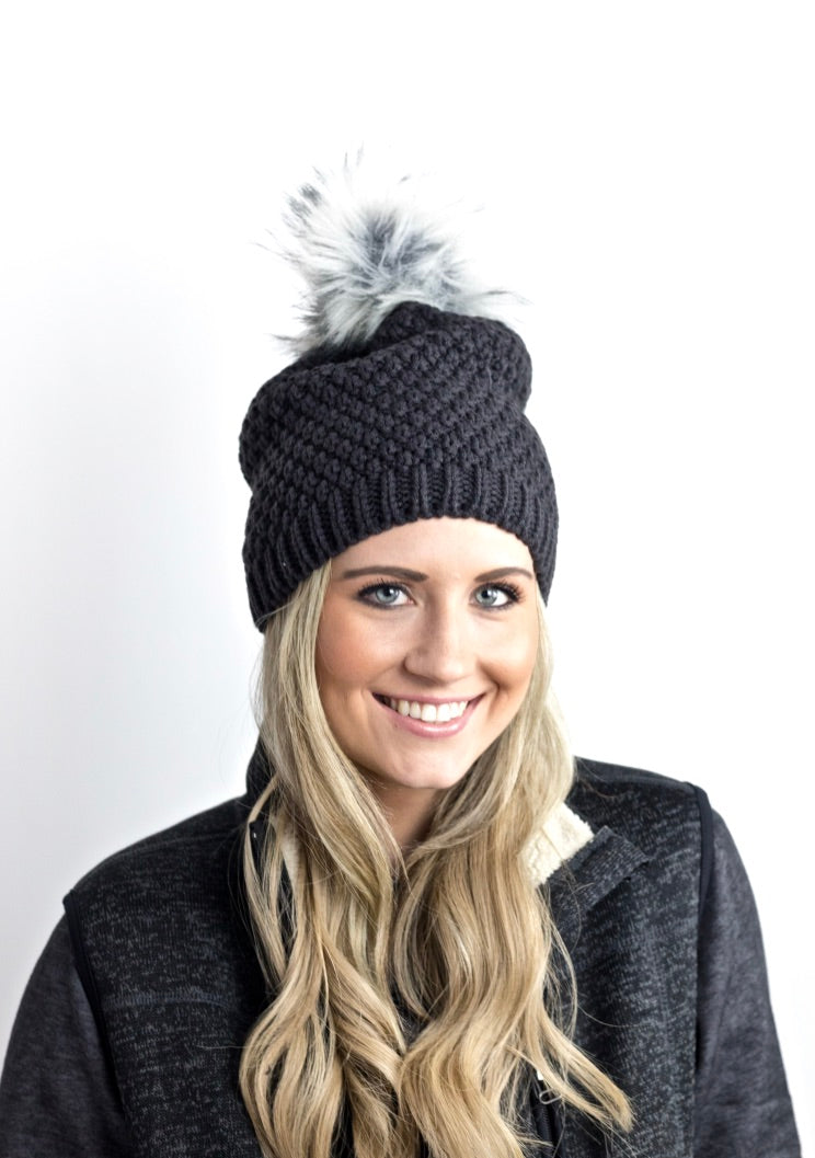 Model wearing F-Pom hat in jetwash gray with arctic faux fur fox pom